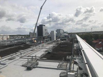 Arbeiten am Flachdach des Kontorhauses in Wolfsburg.