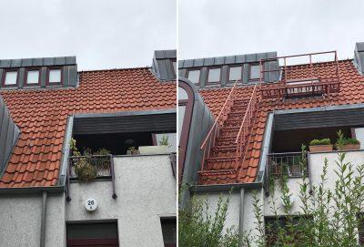 Nachträglich installiertes Notausstiegsfenster mit Rettungspodest an einem Mehrfamilienhaus.